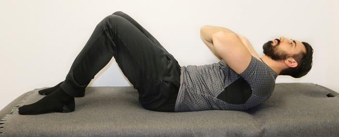 تمرین دراز و نشست برای درمان دیسک کمر